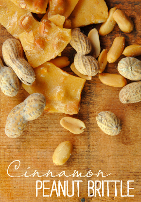 Peanut Brittle with Peanuts on Wood Table